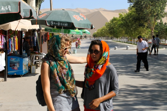 Dunhuang getting scarves for our camel trek that didn't happen